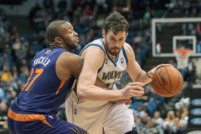 Mar 23, 2014; Minneapolis, MN, USA; Minnesota Timberwolves forward Kevin Love (42) dribbles in the fourth quarter against the Phoenix Suns forward P.J. Tucker (17) at Target Center. Phoenix wins 127-120. Mandatory Credit: Brad Rempel-USA TODAY Sports