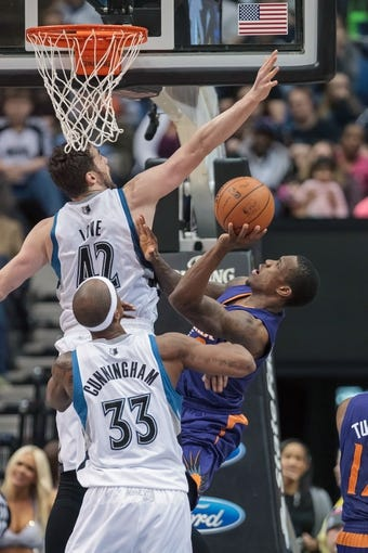 Mar 23, 2014; Minneapolis, MN, USA; Minnesota Timberwolves forward Kevin Love (42) fouls Phoenix Suns guard Eric Bledsoe (2) in the fourth quarter at Target Center. Phoenix wins 127-120. Mandatory Credit: Brad Rempel-USA TODAY Sports