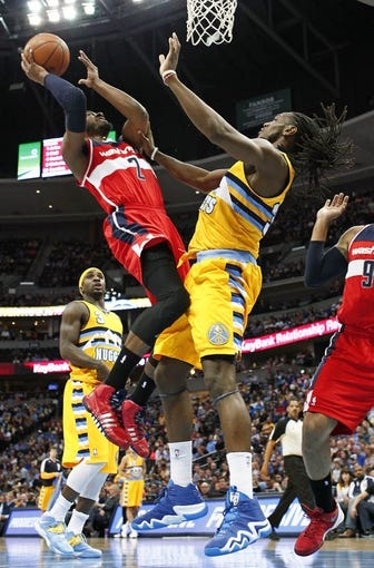 Mar 23, 2014; Denver, CO, USA; Washington Wizards point guard John Wall (2) shoots the ball over Denver Nuggets small forward Kenneth Faried (35) in the second quarter at the Pepsi Center. The Nuggets won 105-102. Mandatory Credit: Isaiah J. Downing-USA TODAY Sports