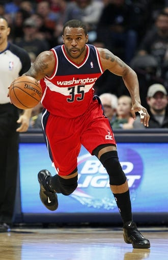 Mar 23, 2014; Denver, CO, USA; Washington Wizards power forward Trevor Booker (35) dribbles the ball in the first quarter against the Denver Nuggets at the Pepsi Center. Mandatory Credit: Isaiah J. Downing-USA TODAY Sports