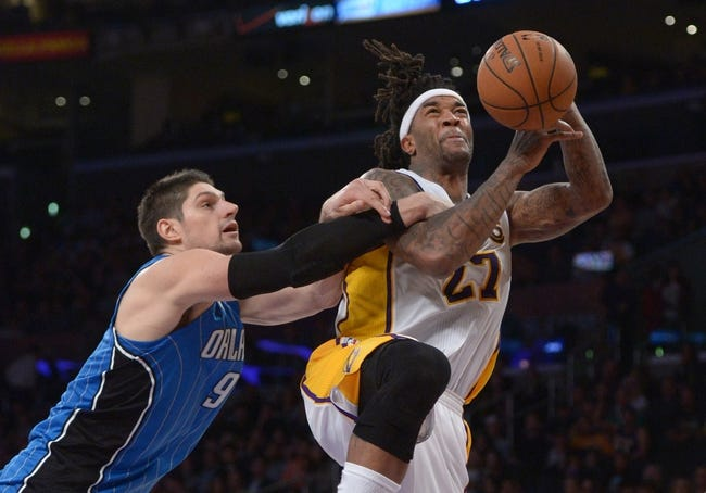 Mar 23, 2014; Los Angeles, CA, USA; Los Angeles Lakers forward Jordan Hill (27) is fouled by Orlando Magic center Nikola Vucevic (9) at Staples Center. The Lakers won 103-94. Mandatory Credit: Kirby Lee-USA TODAY Sports