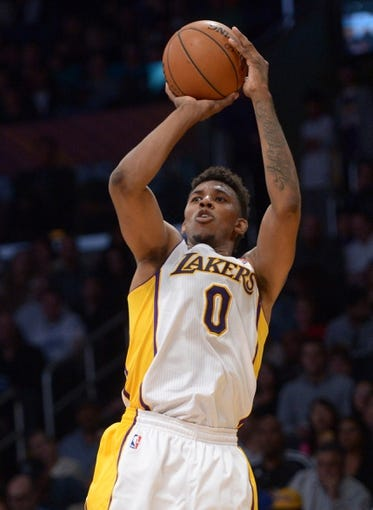 Mar 23, 2014; Los Angeles, CA, USA; Los Angeles Lakers guard Nick Young (0) shoots the ball against the Orlando Magic at Staples Center. The Lakers won 103-94. Mandatory Credit: Kirby Lee-USA TODAY Sports