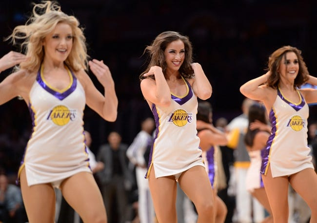 Mar 23, 2014; Los Angeles, CA, USA; The Los Angeles Lakers girls dance during a stoppage in play against the Orlando Magic at Staples Center. Mandatory Credit: Kirby Lee-USA TODAY Sports