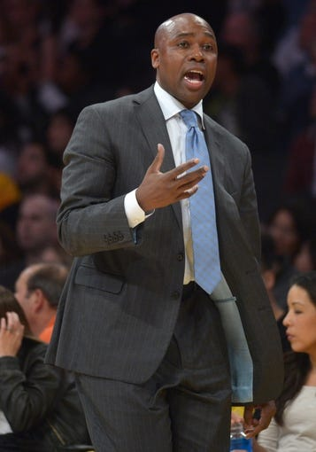 Mar 23, 2014; Los Angeles, CA, USA; Orlando Magic coach Jacque Vaughn gestures from the sidelines during the game against the Los Angeles Lakers at Staples Center. The Lakers won 103-94. Mandatory Credit: Kirby Lee-USA TODAY Sports