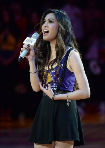 Mar 23, 2014; Los Angeles, CA, USA; Actress and entertainer Ashley Argota sings the national anthem prior to the game between the Orlando Magic and the Los Angeles Lakers at Staples Center. Mandatory Credit: Kirby Lee-USA TODAY Sports