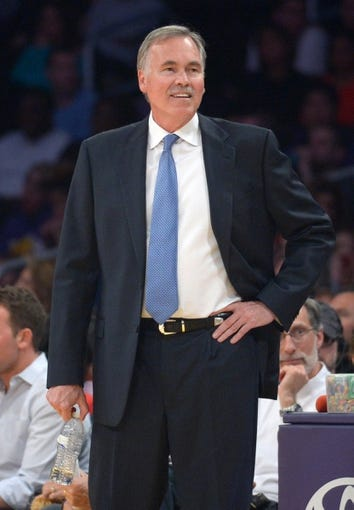 Mar 23, 2014; Los Angeles, CA, USA; Los Angeles Lakers coach Mike D'Antoni stands on the sidelines against the Orlando Magic at Staples Center. Mandatory Credit: Kirby Lee-USA TODAY Sports