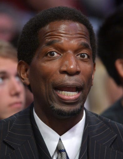 Mar 23, 2014; Los Angeles, CA, USA; Los Angeles Lakers former player A.C. Green reacts from the stands against the Orlando Magic at Staples Center. Mandatory Credit: Kirby Lee-USA TODAY Sports