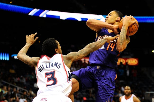 Mar 24, 2014; Atlanta, GA, USA; Phoenix Suns guard Gerald Green (14) is fouled by Atlanta Hawks guard Louis Williams (3) on his way to the basket during the first half at Philips Arena. Mandatory Credit: Dale Zanine-USA TODAY Sports