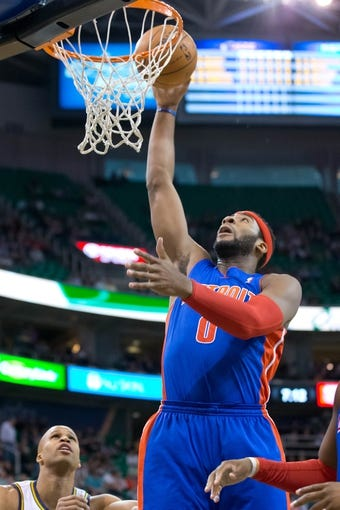 Mar 24, 2014; Salt Lake City, UT, USA; Detroit Pistons center Andre Drummond (0) goes up for a shot during the first quarter against the Utah Jazz at EnergySolutions Arena. Mandatory Credit: Russ Isabella-USA TODAY Sports