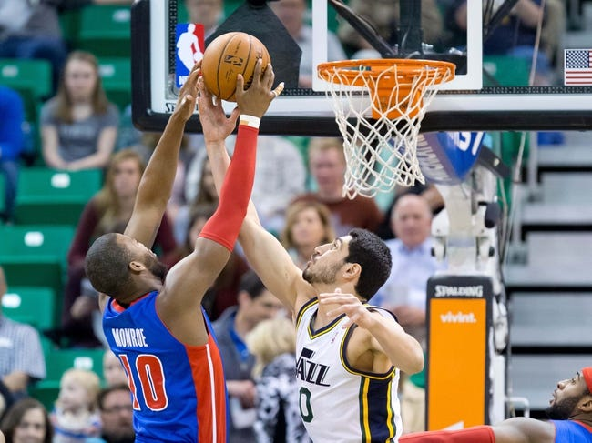Mar 24, 2014; Salt Lake City, UT, USA; Detroit Pistons forward Greg Monroe (10) and Utah Jazz center Enes Kanter (0) battle for a rebound during the first quarter at EnergySolutions Arena. Mandatory Credit: Russ Isabella-USA TODAY Sports