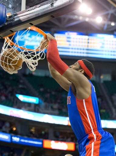 Mar 24, 2014; Salt Lake City, UT, USA; Detroit Pistons center Andre Drummond (0) dunks during the first quarter against the Utah Jazz at EnergySolutions Arena. Mandatory Credit: Russ Isabella-USA TODAY Sports