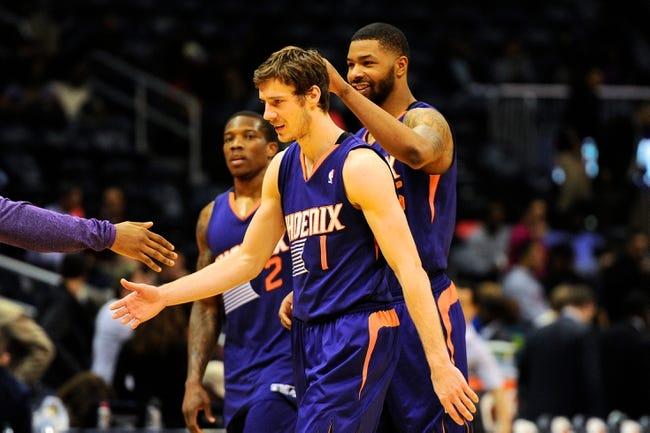Mar 24, 2014; Atlanta, GA, USA; Phoenix Suns guard Goran Dragic (1) is greeted by teammates after the Suns defeated the Atlanta Hawks at Philips Arena. The Suns defeated the Hawks 102-95. Mandatory Credit: Dale Zanine-USA TODAY Sports
