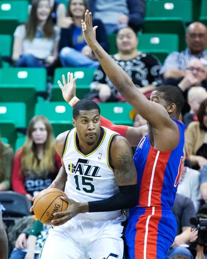 Mar 24, 2014; Salt Lake City, UT, USA; Detroit Pistons forward Greg Monroe (10) defends against Utah Jazz center Derrick Favors (15) during the first half at EnergySolutions Arena. Mandatory Credit: Russ Isabella-USA TODAY Sports
