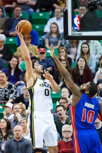 Mar 24, 2014; Salt Lake City, UT, USA; Utah Jazz center Enes Kanter (0) shoots over Detroit Pistons forward Greg Monroe (10) during the first half at EnergySolutions Arena. Mandatory Credit: Russ Isabella-USA TODAY Sports