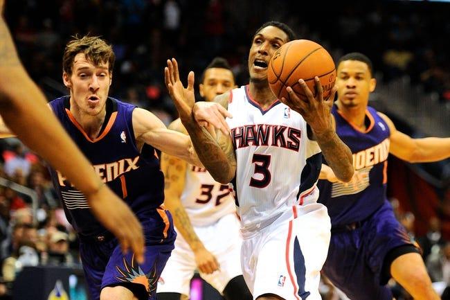 Mar 24, 2014; Atlanta, GA, USA; Atlanta Hawks guard Louis Williams (3) works to get past Phoenix Suns guard Goran Dragic (1) during the second half at Philips Arena. The Suns defeated the Hawks 102-95. Mandatory Credit: Dale Zanine-USA TODAY Sports