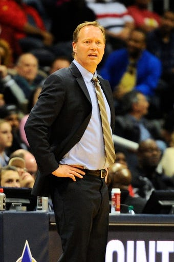 Mar 24, 2014; Atlanta, GA, USA; Atlanta Hawks head coach Mike Budenholzer reacts to the action against the Phoenix Suns during the second half at Philips Arena. The Suns defeated the Hawks 102-95. Mandatory Credit: Dale Zanine-USA TODAY Sports