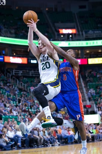 Mar 24, 2014; Salt Lake City, UT, USA; Utah Jazz guard Gordon Hayward (20) is fouled by Detroit Pistons guard Kentavious Caldwell-Pope (5) during the second half at EnergySolutions Arena. The Pistons won 114-94. Mandatory Credit: Russ Isabella-USA TODAY Sports