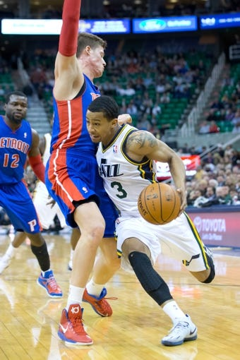 Mar 24, 2014; Salt Lake City, UT, USA; Utah Jazz guard Trey Burke (3) is fouled by Detroit Pistons forward Jonas Jerebko (33) during the second half at EnergySolutions Arena. The Pistons won 114-94. Mandatory Credit: Russ Isabella-USA TODAY Sports