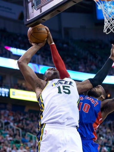 Mar 24, 2014; Salt Lake City, UT, USA; Detroit Pistons forward Greg Monroe (10) blocks the shot of Utah Jazz center Derrick Favors (15) during the second half at EnergySolutions Arena. The Pistons won 114-94. Mandatory Credit: Russ Isabella-USA TODAY Sports