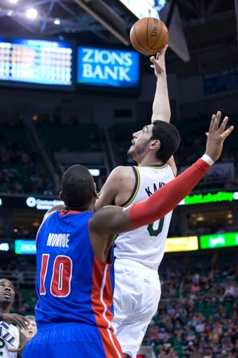 Mar 24, 2014; Salt Lake City, UT, USA; Utah Jazz center Enes Kanter (0) shoots over Detroit Pistons forward Greg Monroe (10) during the second half at EnergySolutions Arena. The Pistons won 114-94. Mandatory Credit: Russ Isabella-USA TODAY Sports