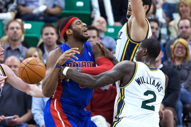 Mar 24, 2014; Salt Lake City, UT, USA; Utah Jazz forward Marvin Williams (2) fouls Detroit Pistons center Andre Drummond (0) during the second half at EnergySolutions Arena. The Pistons won 114-94. Mandatory Credit: Russ Isabella-USA TODAY Sports