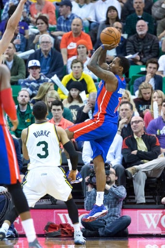 Mar 24, 2014; Salt Lake City, UT, USA; Detroit Pistons guard Brandon Jennings (7) shoots during the second half against the Utah Jazz at EnergySolutions Arena. The Pistons won 114-94. Mandatory Credit: Russ Isabella-USA TODAY Sports