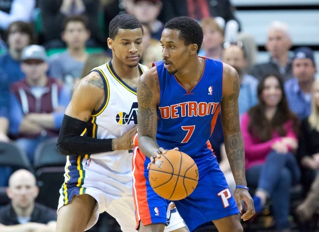 Mar 24, 2014; Salt Lake City, UT, USA; Utah Jazz guard Trey Burke (3) defends against Detroit Pistons guard Brandon Jennings (7) during the second half at EnergySolutions Arena. The Pistons won 114-94. Mandatory Credit: Russ Isabella-USA TODAY Sports