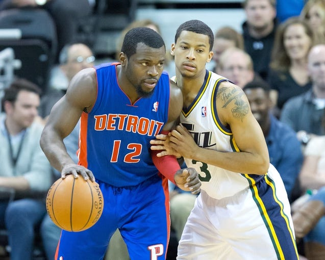 Mar 24, 2014; Salt Lake City, UT, USA; Utah Jazz guard Trey Burke (3) defends against Detroit Pistons guard Will Bynum (12) during the second half at EnergySolutions Arena. The Pistons won 114-94. Mandatory Credit: Russ Isabella-USA TODAY Sports