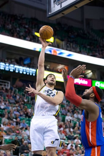 Mar 24, 2014; Salt Lake City, UT, USA; Utah Jazz center Enes Kanter (0) shoots over Detroit Pistons center Andre Drummond (0) during the second half at EnergySolutions Arena. The Pistons won 114-94. Mandatory Credit: Russ Isabella-USA TODAY Sports