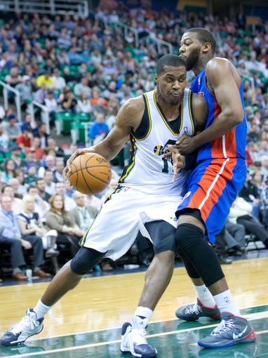 Mar 24, 2014; Salt Lake City, UT, USA; Detroit Pistons forward Greg Monroe (10) defends against Utah Jazz center Derrick Favors (15) during the second half at EnergySolutions Arena. The Pistons won 114-94. Mandatory Credit: Russ Isabella-USA TODAY Sports