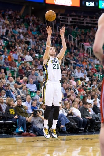 Mar 24, 2014; Salt Lake City, UT, USA; Utah Jazz guard Gordon Hayward (20) shoots during the second half against the Detroit Pistons at EnergySolutions Arena. The Pistons won 114-94. Mandatory Credit: Russ Isabella-USA TODAY Sports