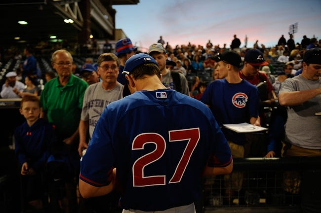 Mar 18, 2014; Surprise, AZ, USA; Chicago Cubs left fielder Josh Vitters (27) signs autographs before facing the Texas Rangers at Surprise Stadium. Mandatory Credit: Joe Camporeale-USA TODAY Sports