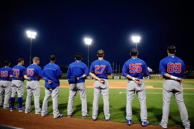 Mar 18, 2014; Surprise, AZ, USA; Chicago Cubs members look on during the national anthem before facing the Texas Rangers at Surprise Stadium. Mandatory Credit: Joe Camporeale-USA TODAY Sports