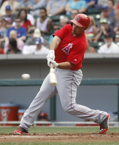 Mar 25, 2014; Mesa, AZ, USA; Los Angeles Angels left fielder Raul Ibanez (28) hits in the first inning against the Chicago Cubs at HoHoKam Park. Mandatory Credit: Rick Scuteri-USA TODAY Sports