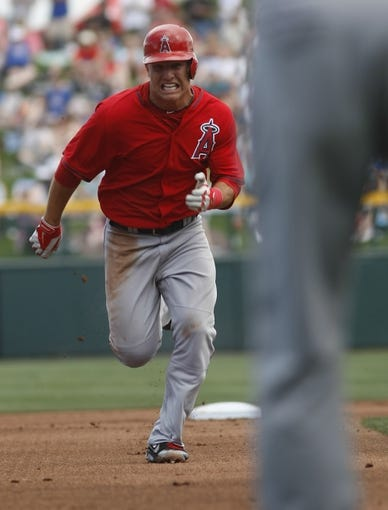 Mar 25, 2014; Mesa, AZ, USA; Los Angeles Angels center fielder Mike Trout (27) runs to third base in the first inning against the Chicago Cubs at HoHoKam Park. Mandatory Credit: Rick Scuteri-USA TODAY Sports