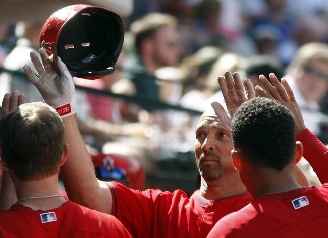Mar 25, 2014; Mesa, AZ, USA; Los Angeles Angels left fielder Raul Ibanez (28) gets high fives after hitting a solo homerun in the fourth inning against the Chicago Cubs at HoHoKam Park. Mandatory Credit: Rick Scuteri-USA TODAY Sports