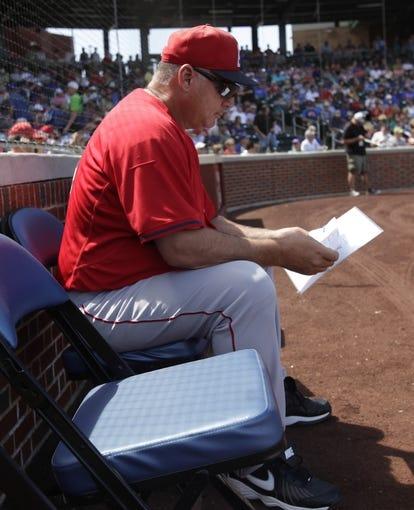 Mar 25, 2014; Mesa, AZ, USA; Los Angeles Angels manager Mike Scioscia (14) before a game against the Chicago Cubs at HoHoKam Park. Mandatory Credit: Rick Scuteri-USA TODAY Sports