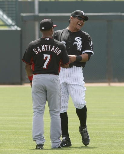 Mar 26, 2014; Phoenix, AZ, USA; Chicago White Sox right fielder Avisail Garcia (26) and Cincinnati Reds shortstop Ramon Santiago (7) talk before a game at Camelback Ranch. Mandatory Credit: Rick Scuteri-USA TODAY Sports