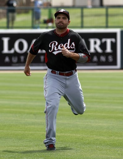 Mar 26, 2014; Phoenix, AZ, USA; Cincinnati Reds first baseman Joey Votto (19) stretches before a game against the Chicago White Sox at Camelback Ranch. Mandatory Credit: Rick Scuteri-USA TODAY Sports