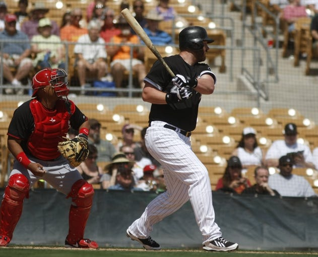Mar 26, 2014; Phoenix, AZ, USA; Chicago White Sox designated hitter Adam Dunn (44) doubles in the first inning against the Cincinnati Reds at Camelback Ranch. Mandatory Credit: Rick Scuteri-USA TODAY Sports