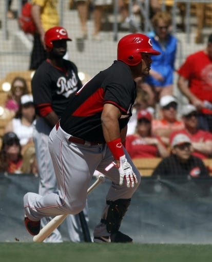 Mar 26, 2014; Phoenix, AZ, USA; Cincinnati Reds catcher Brayan Pena (29) drives in a run in the third inning against the Chicago White Sox at Camelback Ranch. Mandatory Credit: Rick Scuteri-USA TODAY Sports