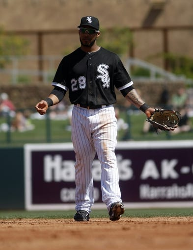 Mar 26, 2014; Phoenix, AZ, USA; Chicago White Sox second baseman Leury Garcia (28) reacts after making an error against the Cincinnati Reds at Camelback Ranch. Mandatory Credit: Rick Scuteri-USA TODAY Sports
