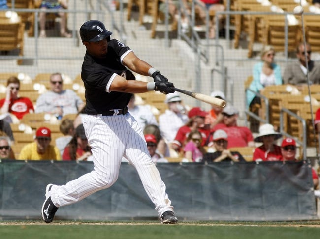 Mar 26, 2014; Phoenix, AZ, USA; Chicago White Sox first baseman Jose Abreu (79) hits a three run home run against the Cincinnati Reds in the fourth inning at Camelback Ranch. Mandatory Credit: Rick Scuteri-USA TODAY Sports