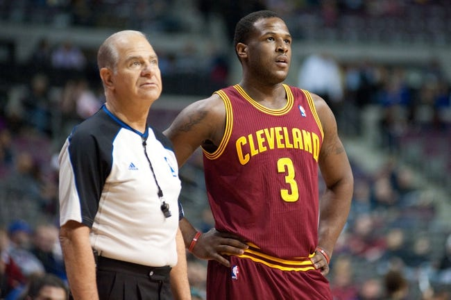 Mar 26, 2014; Auburn Hills, MI, USA; Cleveland Cavaliers guard Dion Waiters (3) and referee Bennett Salvatore (15) during the first quarter against the Detroit Pistons at The Palace of Auburn Hills. Mandatory Credit: Tim Fuller-USA TODAY Sports