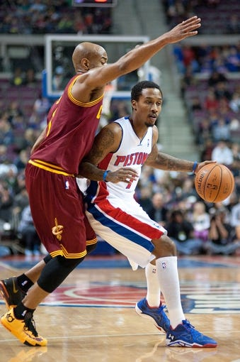 Mar 26, 2014; Auburn Hills, MI, USA; Cleveland Cavaliers guard Jarrett Jack (1) defends Detroit Pistons guard Brandon Jennings (7) during the first quarter at The Palace of Auburn Hills. Mandatory Credit: Tim Fuller-USA TODAY Sports