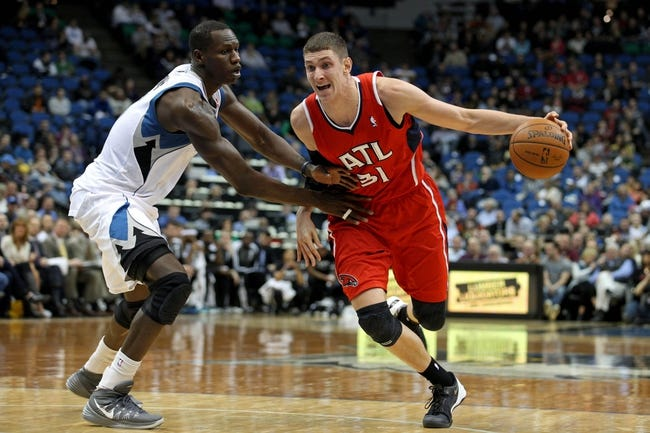 Mar 26, 2014; Minneapolis, MN, USA; Atlanta Hawks center Mike Muscala (31) drives past Minnesota Timberwolves center Gorgui Dieng (5) during the second quarter at Target Center. Mandatory Credit: Brace Hemmelgarn-USA TODAY Sports
