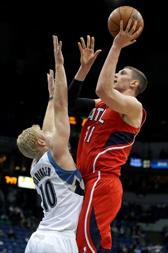 Mar 26, 2014; Minneapolis, MN, USA; Atlanta Hawks center Mike Muscala (31) shoots over Minnesota Timberwolves forward Chase Budinger (10) during the second quarter at Target Center. Mandatory Credit: Brace Hemmelgarn-USA TODAY Sports