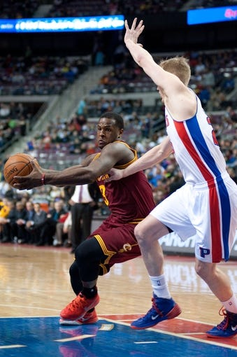 Mar 26, 2014; Auburn Hills, MI, USA; Detroit Pistons forward Kyle Singler (25) guards Cleveland Cavaliers guards Dion Waiters (3) during the third quarter at The Palace of Auburn Hills. Cleveland won 97-96. Mandatory Credit: Tim Fuller-USA TODAY Sports