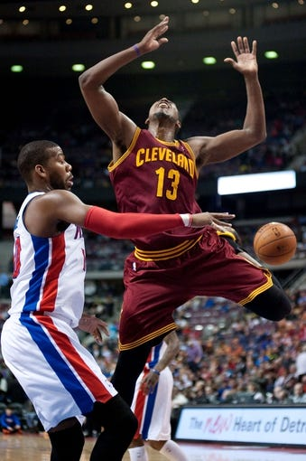 Mar 26, 2014; Auburn Hills, MI, USA; Detroit Pistons forward Greg Monroe (10) blocks Cleveland Cavaliers forward Tristan Thompson (13) during the third quarter at The Palace of Auburn Hills. Cleveland won 97-96. Mandatory Credit: Tim Fuller-USA TODAY Sports