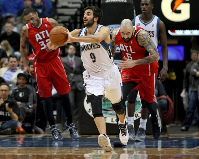 Mar 26, 2014; Minneapolis, MN, USA; Minnesota Timberwolves guard Ricky Rubio (9) passes during the third quarter against the Atlanta Hawks at Target Center. The Timberwolves defeated the Hawks 107-83. Mandatory Credit: Brace Hemmelgarn-USA TODAY Sports